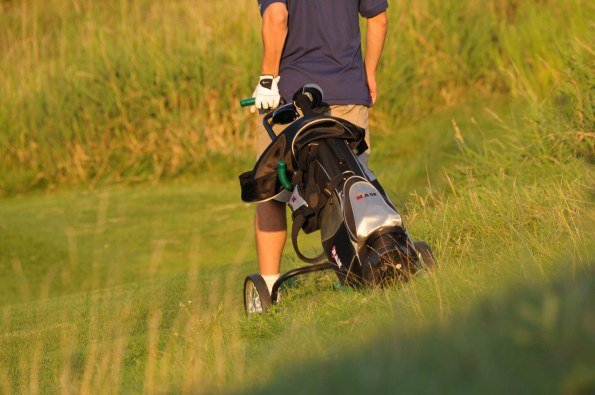 Golfer with golf bag